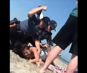 少女が警察官に殴られる