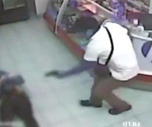 武装強盗が銃で撃たれる