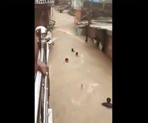 【衝撃】洪水を利用して素早く移動するインド人達がヤバすぎる