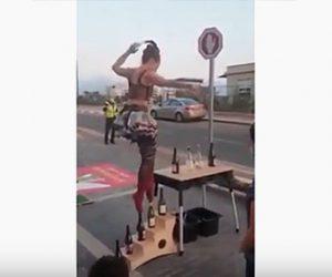 【神業】バランスを取りながらボトルの上を歩く女性が凄い